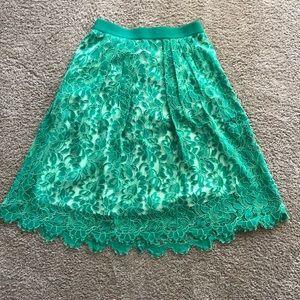 Green skirt by Eva Mendez
